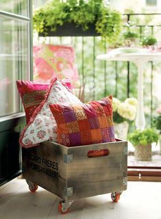 Crate & Pillows - should put legs on those antique shop finds.... Taller ones on a shallower crate could make a side table... Two together for a coffee table??