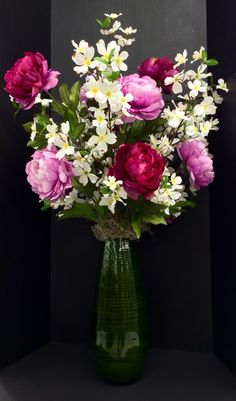 Spring 2015 Season Floral: mauve and fuchsia peonies and dogwood branches nested on Spanish moss on a tall dark green bamboo vase. Original design and arrangement by http://nfmdesign.synthasite.com/