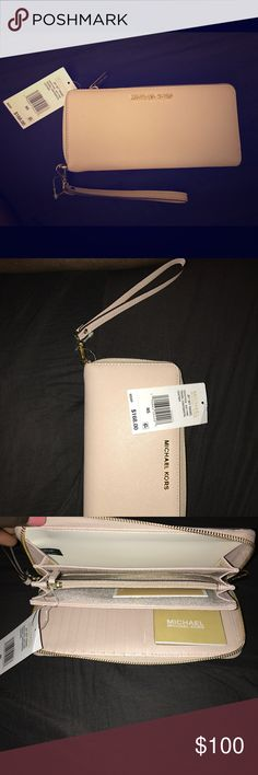 Brand new authentic Michael Kors wallet Light pink blush/beige color with gold letters. Multiple credit card holder, & arm strap to carry as a clutch. Michael Kors Bags Clutches & Wristlets