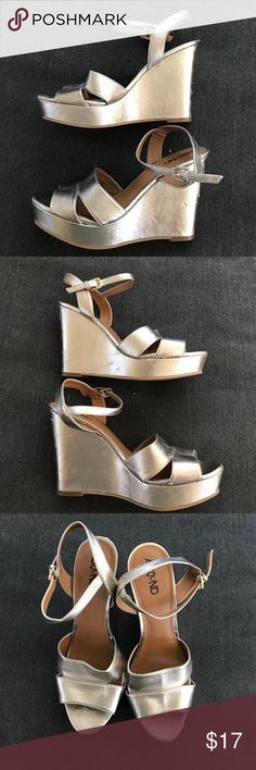 Wedges These super comfy metallic goldish-silverish wedges are super cute and go with dresses, shorts or pants. I wore them once to a wedding I was in. Size 8 1/2 M. The heel is 4 1/2 inches! I bought them from Nordstrom Rack about a year ago. Bottoms are worn and the heels have scuffs - so I'm selling them for cheap! :) Abound Shoes Wedges