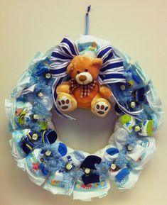Baby Shower gift-  Diaper wreath made of diapers, baby socks, teddy bear, flowers and ribbons