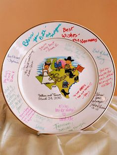 Texas Couple Platter... Our personalized wedding platters are perfect for showers, bridal luncheons, rehearsal dinners or any other  event. Change your hair color and skin color. No need to re-fire after the plate is signed by your guests like other sign-in platters. Guest sign in platter is a perfect alternative to the old fashioned guest book. Plates ship fast and are a reasonable $49.95. Can't figure out which design you like best? There are many more to choose from.