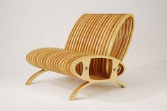 """CNC cut plywood """"Loop Chair"""" by American designer Carlo Lorenzetti… Furniture For Small Spaces, Unique Furniture, Furniture Design, Space Furniture, Luxury Furniture, Plywood Chair, Plywood Furniture, Wooden Rocking Chairs, Cool Chairs"""
