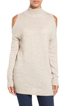 Cold-shoulder cutouts perfectly balance the long sleeves and cozy turtleneck of this finely knit sweater.