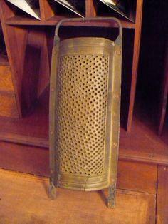 Antique copper grater. $22.00, via Etsy.