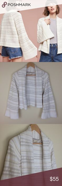 Anthropologie Moth Mahalia Bell Sleeve Cardigan Pre-owned in good condition. No holes, rips, stains, or other defects.   Garment measurements in inches: •Bust (armpit to armpit):46 •Waist (natural waist): 46 •Sleeve (middle neck to sleeve hem): 29 •Length (shoulder to hem): 19 86% cotton, 8% nylon, 6% acrylic Anthropologie Sweaters Cardigans