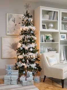 white, blue, and silver christmas with feather boas on tree to make snow. Love the softness of the boas