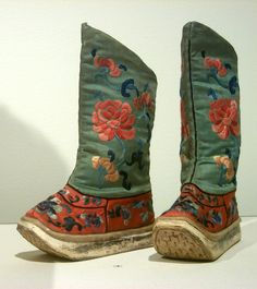It's #TuesdayShoesday! This pair of boots from Bejing, China were meant for a young boy. They are made of silk, cotton, and leather with embroidered chrysanthemums and peonies. ca. 1900.