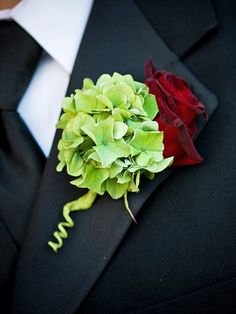 The men's boutonnières featured pale green hydrangeas paired with red roses, a combination that really popped against the mens' classic black tuxes.