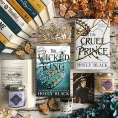 Did you guys see the cover reveal for The Wicked King this past weekend? I am in love with this cover its so gorgeous. Im so excited for this book I can hardly stand it. It has now become my most anticipated read of 2019. I now also need all the Cruel Prince merchandise I can find. Whats a series you need more merch for? Jude and Cruel Prince candles by @noxtolumoscandleco Use my code TINE20 Cardan candle Cardan print and The Cruel Prince from the @fairyloot Talk Faerie to Me January box. Da