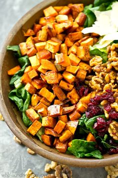 This fall harvest salad is piled high with spiced roasted sweet potatoes, sweet candied walnuts, and tossed in a tangy maple dressing for a gorgeous Thanksgiving salad you won't be able to get enough of!