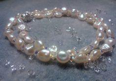 Due file di perle e cristalli swarovski