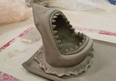 Shark sushi plate in the making #shark #clay #ceramics #sculpture #art #craft #sharks #sushi #pottery #waves #sharkplate #teeth #ocean
