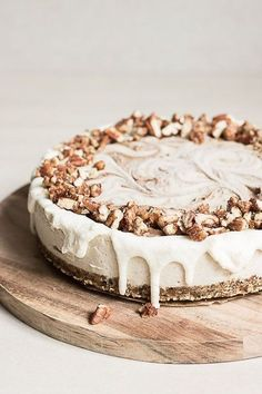 A buttery pecan oat crust, cardamom vanilla filling and a sweet cinnamon swirl topped with melted creamed coconut and cinnamon candied pecans.