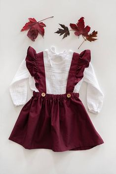 This lovely maroon cotton dress is very versatile and can be worn year round on multiple holidays, occasions, or everyday adventures. The straps are crossed in the back and tied through a loop for ultimate adjustability. The dress has an elasticated waist for ultimate comfort and to