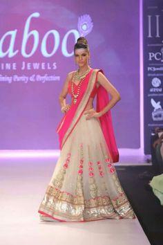 Lovely pink with orange and white net #designer floral design #lehengacholi