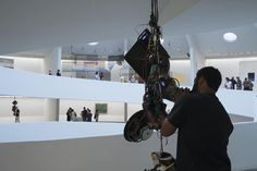 "In 2015 Kevin Beasley's work ""Strange Fruit (Pair 1)"" entered the Guggenheim's collection and was exhibited with a second sculpture ""Strange Fruit (Pair 2)"" in ""Storylines: Contemporary Art at the Guggenheim."" Beasley's use of sculpture and sonic performance to explore the cultural connotations of objects and sound is apparent in both works made of resin-coated sneakers embedded with live microphones and paired with speakers. Suspending these objects in the space of the Guggenheim's rotunda…"