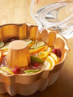 The party invites are sent, and you chose the punch recipe. Now learn how to make an ice ring for punch that doubles as a pretty centerpiece. Layer fresh fruits, herbs, and even edible flowers to make a beautiful ring of ice. If you don't have time to freeze a whole ring, we've got ideas for ice cups and ice shards, too.