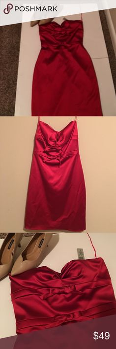Cach'e Dress Sz 8 NWT A sexy two bow sweetheart neckline strapless dress Sz 8. It's definitely a night on the town/special event kind of dress. Please ask all questions before buying no refunds Cache Dresses Strapless