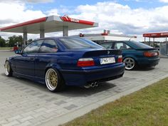 Blue BMW e36 coupe on cult classic Mille Miglia MM2000 wheels