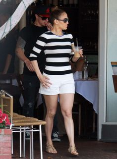 Jennifer Lopez Pear shape shorts and top off with strip shirt to draw attention upward and the strips balance out her top half to bottom half