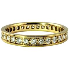 Cartier Classic Diamond Yellow Gold Eternity Ring. Certificate and Cartier Box. | From a unique collection of vintage band rings at https://www.1stdibs.com/jewelry/rings/band-rings/