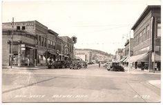 Norway, Michigan, Cars Parked at North Main Street Stores, 1940's RPPC Postcard