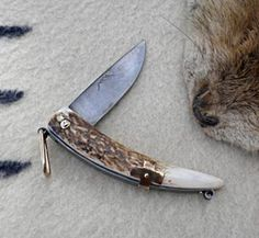 French Trapper Pouch Knives are a very old style of folding knife with an external spring. Forged 5160 high carbon steel with Elk Antler handle. Comes with leather drawstring pouch.