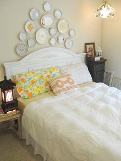 Love the idea of the plates above the bed.