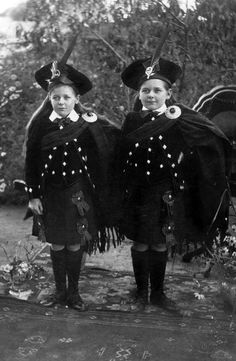 Lorna and Mavis McDonald wearing traditional Scottish Highland dancing costumes, circa 1917. Both of the complete costumes are held in the Museum Victoria collection. Australia. The girls wore the costumes for dance performances in Nullawil and Wycheproof in northern Victoria around 1917.