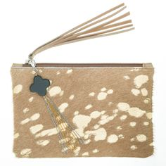 Win A Limited Edition Mooi Pony Skin Clutch