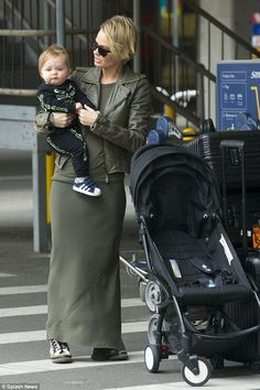 Back in Australia: Lara Bingle was spotted arriving at Sydney airport on Wednesday with son Rocket
