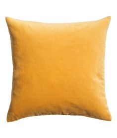 Mustard yellow. Cushion cover in cotton velvet with a concealed zip.