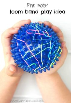 Fine motor activity using a spiky ball and loom bands.