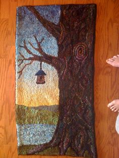 Hand hooked by Pamela Krider Bos. Love the tree colors