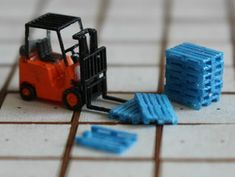 N Scale Pallets by Ngineer and fork lift by Wuttermelon. Pallets are wide, high and long.