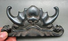 An old Chinese Zitan wood brush stand with bat motif, late Qing dynasty