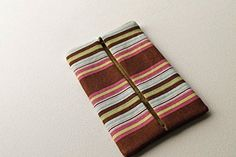 Fabric Tissue Holder in Colorful Stripes. A colorful accessory to carry your kleenex on the go!.
