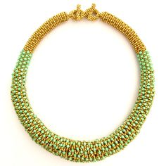 another great idea for embellishing a tubular netted necklace. Love it.