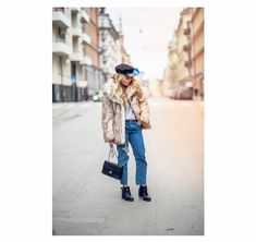 Angelica Blick looks effortlessly chic in this classic fluffy winter outfit! Pairing a large faux fur coat with oversized jeans and chunky ankle boots, Angelica has achieved a casual glamour which we admire! Coat/Jeans: Asos, Boots: Old, Knit: Boohoo, Bag: Chanel.
