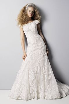 Love the high neckline for this wedding gown - at David's Bridal, Fall 2013