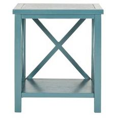 Country aesthetic and contemporary cool intersect in the Safavieh Catania End Table. This subtle piece of home furniture is a welcome addition to any room in the house with its simple yet unique crisscross cutout details on the sides and back. Place the Catania table next to your favorite arm chair or sofa for a stylish yet understated accent. Featuring a sturdy hardwood structure, a fixed shelf beneath for extra storage space and a smooth painted finish.