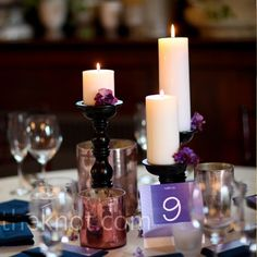 Amy and Brian gave their centerpieces a unique look by playing with candles in varying heights. Every other table featured a garden of flickering candlesticks with bright blooms tucked into the holders.