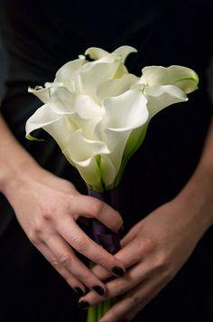 Simple and pretty white calla lily bridesmaids bouquet.