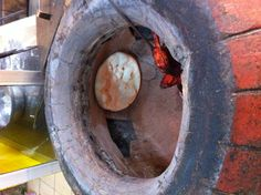 Naan cooked in a authentic Tandoor i.e. a brick oven.
