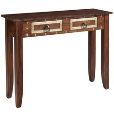 Crafted in India, this console table is carved of richly grained hardwoods and accented with painted details, brass accents and antiqued hardware. It makes an impressive backdrop for collectibles or framed photos, while two metal-glide drawers provide convenient storage for keys, remotes, flatware or stationery. A slim profile means it's an easy fit for entryways, halls or small dining rooms where a little display space is always a beautiful thing.