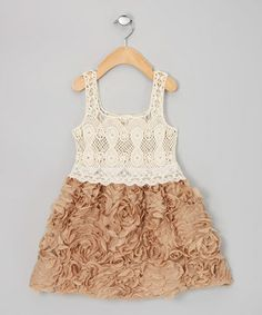 Vintage-inspired open-weave crocheting, a touch of scalloped lace and endless rows of flouncy, frilly ruffles and rosettes turn this simple silhouette into a stunning showpiece. And with no bulky zippers or cumbersome buttons, it's easy to slip on. Any little lady wearing this fabulous, lightweight frock is sure to be the star of any party.