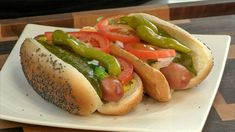 """The iconic Chicago Dog is a hot dog, simmered in water. The cooked dog is topped with yellow mustard, chopped white onions, bright green sweet pickle relish, a dill pickle spear, tomato slices or wedges, pickled sport peppers and a dash of celery salt. The complete assembly of a Chicago hot dog is said to be """"dragged through the garden"""" due to the many toppings. Chicago Hot Dog, Chicago Style, New Cooking, Cooking Ideas, Sweet Pickles, Pickle Relish, White Onion, Barbecue Recipes"""