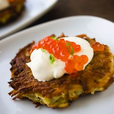 Russian Potato Latke with Dill Creme Fraiche, Salmon and Caviar. Recipe at: http://m.foodandwine.com/recipes/potato-pancakes-with-smoked-salmon-caviar-and-dill-cream