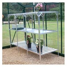 This greenhouse staging is a great addition to greenhouses as it provides a way of keeping plants organised.